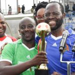 Hon. Gudson Muchina the team Captain of County Assemblies Forum(CAF) football team, receives a trophy from the Kisumu Governor Prof. Anyang' Nyong'o at the Moi Stadium in Kisumu County. This is after CAF football team thrashed the Senate football team 2-1 to lift this year's title.