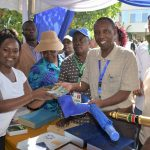 The Speaker of the County Assembly of Kirinyaga Hon. David Githanda flanked by Hon. Gudson Muchina, receives gifts from a staff of the Senate at the Fourth Annual Legislative Summit held in Kisumu city.