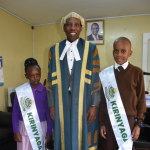 The Speaker Hon. David Githanda with Kenya's Ambassadors to  the future; Aerial Kihara and Joan Nyawira Karani. The two children are  the country's  Ambassadors to the Future representing  Kirinyaga County.  The two are a part of a team commissioned by the the president H.E Uhuru  Kenyatta during the 15th  National Prayer Breakfast as Kenya's  Ambassadors to the Future on National Unity.