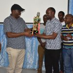Members of the Service Board; Hon Elisha Muriithi, Mr. Eric Muchina and the Clerk  Mr. Kamau Aidi  receive a trophy from the County Assembly darts team. The team  emerged position three in the second edition of the County Assemblies Sports Association games held in Eldoret- Uasin Gishu County.